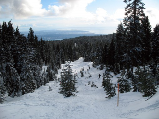 A snowshoe runner descends from Hollyburn Mountain