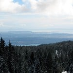 A view of Kitsilano and Richmond in the distance from the snowshoe trail of Hollyburn Mountain