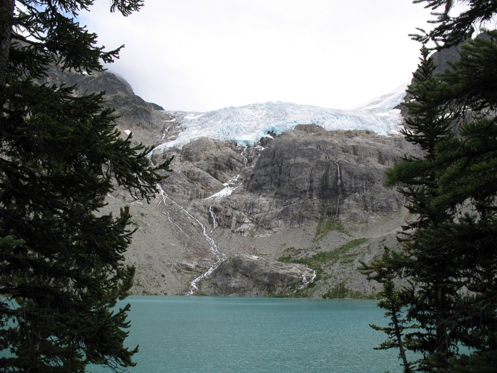 A view of Joffre Lakes Falls cascading down the rocks from the opposite side of Upper Joffre Lakes