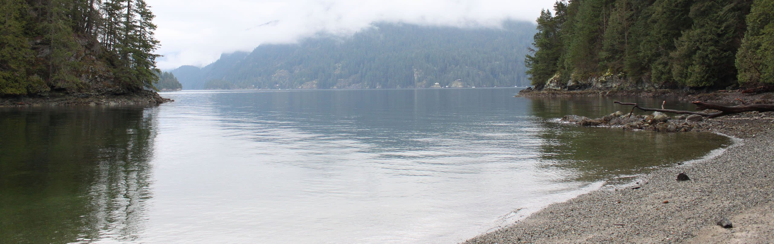The view of Indian Arm from Jug Island Beach in Belcarra