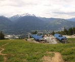 A view looking down at the Wizard and Solar Coaster chairlifts along the Ascent Trail on Blackcomb