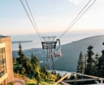 The Grouse Mountain gondola arrives at the top of Grouse Mountain