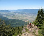 Sitting at the rocky viewpoint on Elk Mountain, having lunch and looking out towards the Fraser Valley