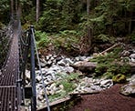 The metal suspension bridge near Norvan Falls that takes you into the backcountry
