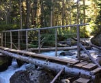 A bridge crossing 19 Mile Creek on the way up to Iceberg Lake