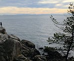 People on the rocks soaking in the views at Lighthouse Park in West Vancouver
