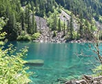 The turqoise colour of Lindeman Lake in Chilliwack, BC