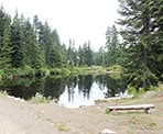 A view across First Lake with the new Hollyburn lodge between the trees