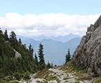 A view of the distant mountains near the top of Mount Seymour