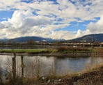 A view across the Pitt River of the distant mountains