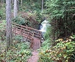 The bridge crossing Rolley Creek near the upper falls