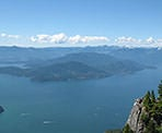The view of Howe Sound and the lookout on the rocky cliff from St Mark's Summit